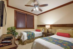 A bed or beds in a room at Ko Olina Beach Villa, 14th Floor, Full Ocean View