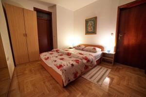 A bed or beds in a room at Apartment Đakovo