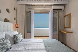 A bed or beds in a room at Gonia Residences