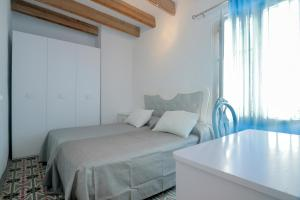 A bed or beds in a room at Apartmento Chic
