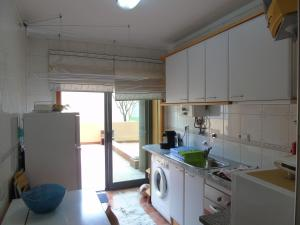 A kitchen or kitchenette at Alojamento Varandas do Parque