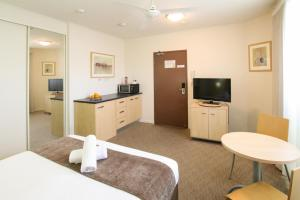 A seating area at Caloundra Central Apartment Hotel