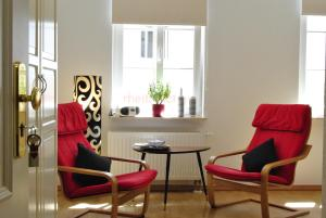 A seating area at Appartement Dresden