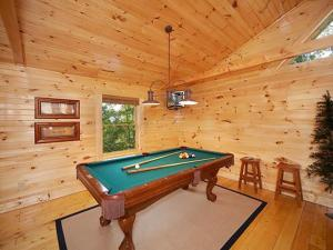 A pool table at A Touch of Class Holiday home