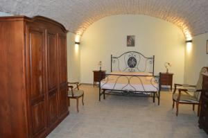A bed or beds in a room at Appartamento Arcobaleno