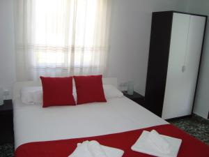 A bed or beds in a room at Apartamento El Hechizo