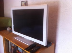 A television and/or entertainment centre at Apartments Renato