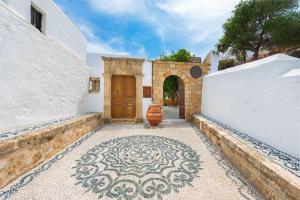 A porch or other outdoor area at Luxury Villa Eftihia Lindos