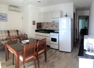 A kitchen or kitchenette at Cancun Beach Aparthotel Brisas