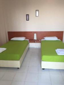 Een kamer bij Aprilis Apartments
