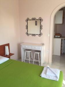 Een bed of bedden in een kamer bij Aprilis Apartments