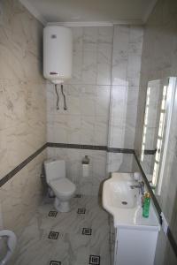 Ванная комната в Elit Apartments on Shashkevycha