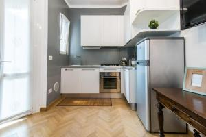 A kitchen or kitchenette at Viale Corsica Apartment