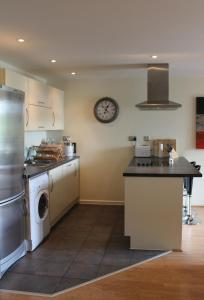 A kitchen or kitchenette at Chelmsford Serviced Apartments