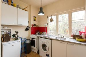 A kitchen or kitchenette at Artist Flat in Camden Town