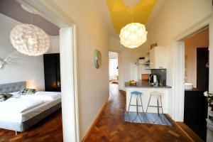 Vuode tai vuoteita majoituspaikassa Leuhusen Boutique Apartments