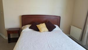 A bed or beds in a room at Departamento Meseta Pacífico