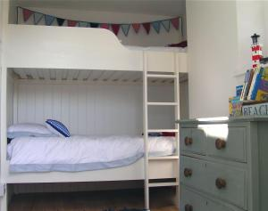 A bunk bed or bunk beds in a room at Seacombe, Devon