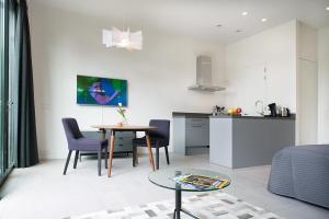 A kitchen or kitchenette at Amstel Villa Studio Garden