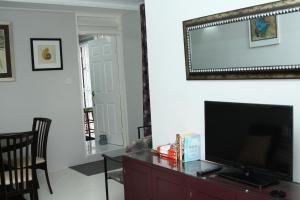 A television and/or entertainment center at A charming one bedroom apartment