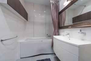 Kylpyhuone majoituspaikassa Kaubamaja Luxury Apartment