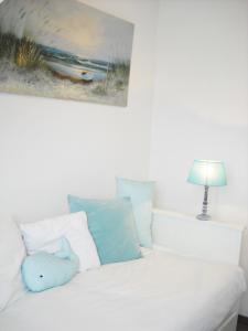 Un ou plusieurs lits dans un hébergement de l'établissement Appartement Cosy Chic 3 Chambres