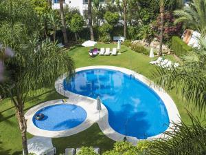 The swimming pool at or near Urban shopping Banús