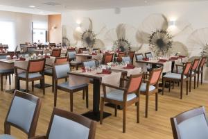 Restaurant ou autre lieu de restauration dans l'établissement Domitys Le Millésime