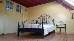 Ein Bett oder Betten in einem Zimmer der Unterkunft Lant van Beloften