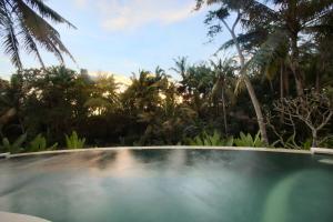 The swimming pool at or near Lotus Villa Ubud