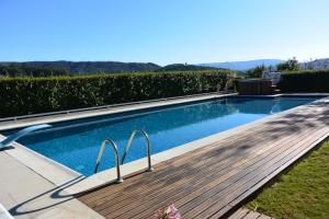 The swimming pool at or near Casa do Lagar