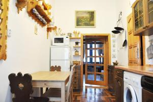A kitchen or kitchenette at Traditional Slovak Apartment