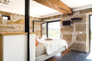 A bunk bed or bunk beds in a room at Villa Lugar do Pego