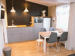 A kitchen or kitchenette at Volcano Apartments