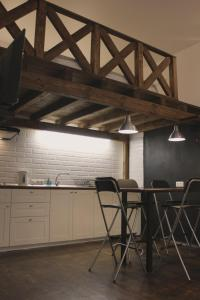 Кухня или мини-кухня в Brestappart Studio Dzerzhynskogo