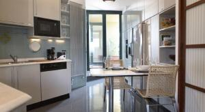 A kitchen or kitchenette at San Siro Apartment