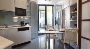 A kitchen or kitchenette at San Siro Apartment