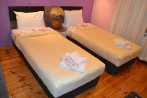 Uma cama ou camas num quarto em Apartment Secession Style