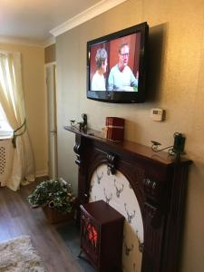 A television and/or entertainment center at 123v Tillicoultry Holiday let