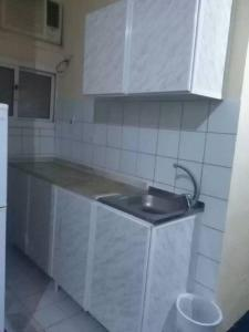 A kitchen or kitchenette at Helm Jeddah Hotel Apartments