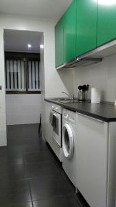 A kitchen or kitchenette at Madrid Rent 3