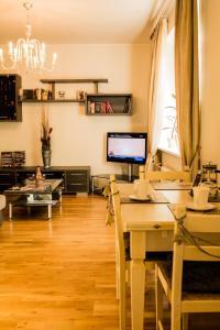 Majoituspaikan Kaubamaja Luxury Apartment ravintola tai vastaava paikka