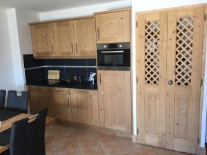 A kitchen or kitchenette at Les Saisies Bisanne