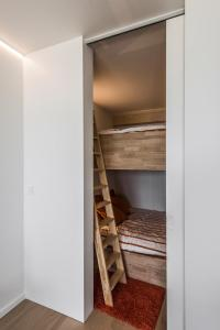 A bunk bed or bunk beds in a room at Studio Zeezicht