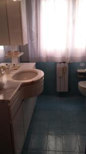 A bathroom at Apartment Candiani