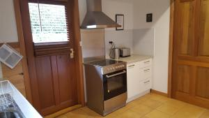 A kitchen or kitchenette at Wisteria Lodge