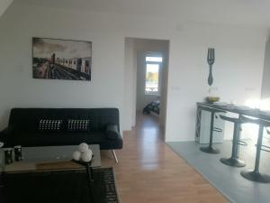 Posezení v ubytování Home Appart