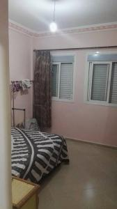 A bed or beds in a room at Zahed Apartment