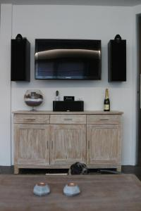 A television and/or entertainment center at La Crème