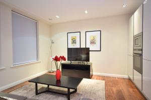 A television and/or entertainment center at Valet Apartments Aston House